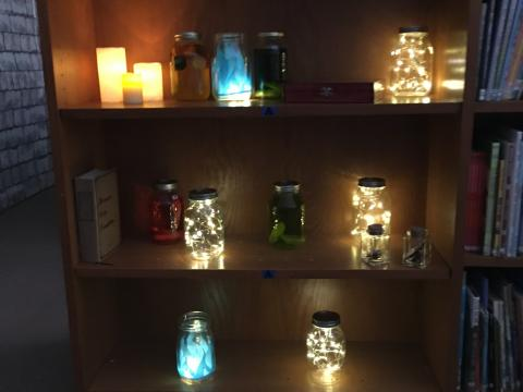Bookshelf with candles