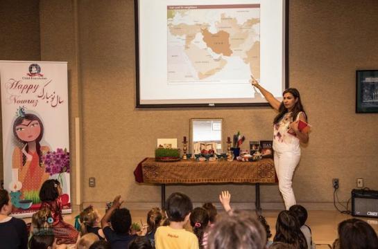 Speaker giving presentation on Nowruz