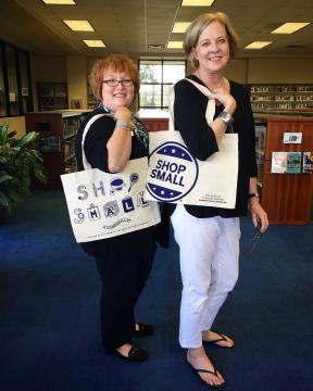 Library staff modeling Shop Small tote bags