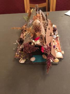 Fairy house created with lots of dried flowers
