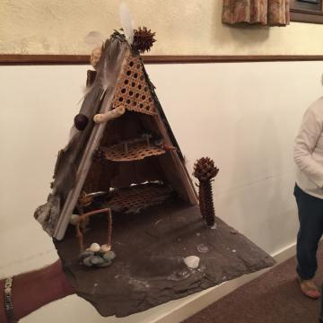 Fairy house created from slate and wicker sheeting