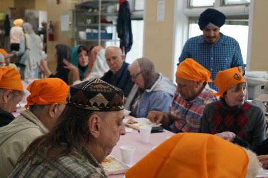 Attendees sharing dinner.