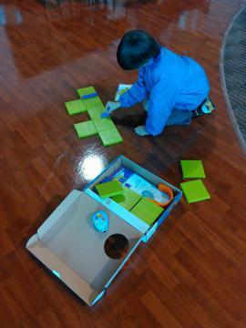 Boy putting together a maze