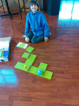 Boy posing with the finished maze