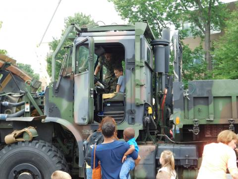 Boy getting a tour of military vehicle