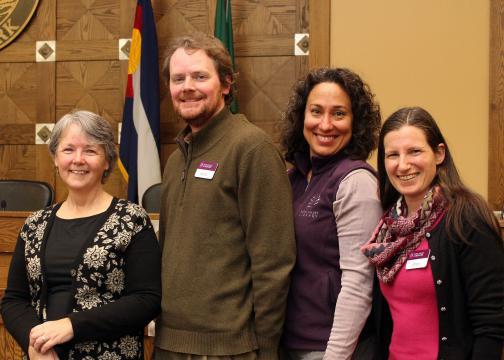 Library staff pose with speaker Elizabeth Skewes.