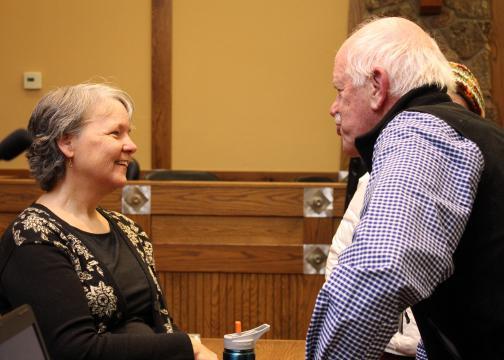 Elizabeth Skewes speaks with a patron.