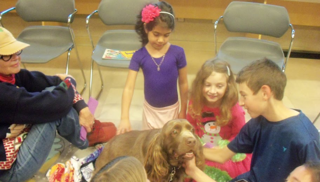 Nigel the spaniel with group of children