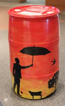 Orange Barrel w/ Black Stencils: EVPL and Youth Care Center, 2015 (coordinated by Michael Cherry and Charles Sutton, Library Experience Manager)