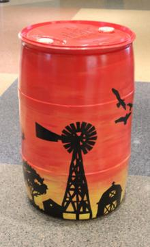 Orange Barrel w/ Black Stencils: EVPL and Youth Care Center, 2015 (coordinated by Michael Cherry and Charles Sutton, Library Experience Manager) 2