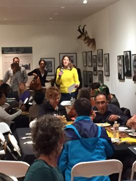 A person stands up to speak at the Breaking Bread with Refugees event.