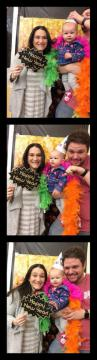 A couple with a baby in the photobooth