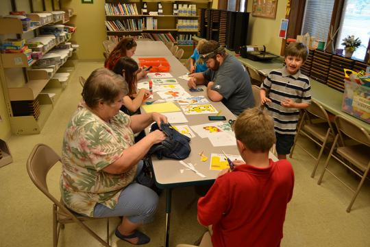 Pokethon participants make origami pikachus