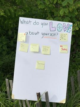 "Post-it wall asking ""What do you love about yourself?"""