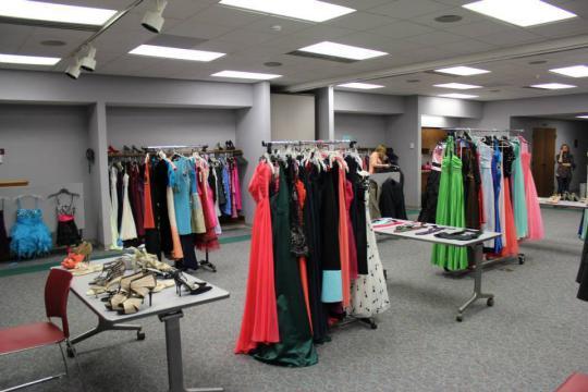 Room full of dresses on racks