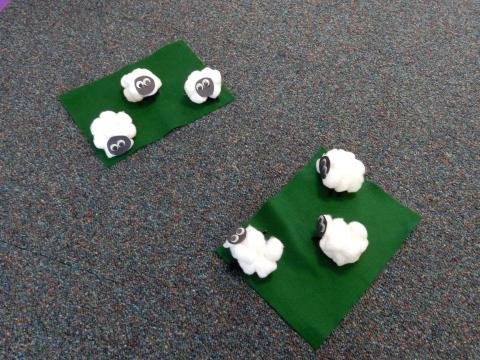 Small felt sheep on mini golf course