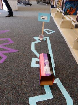 Mini golf course on library floor