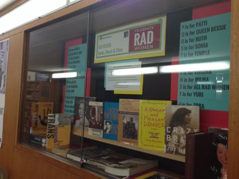 Display case of books and posters about Rad Women