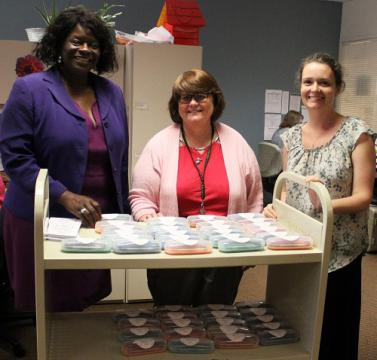 Cobb County librarians, from left, Jo Lahmon, Roxanne Magaw, and Stacy Hill with a group of free eyeglasses provided by the national non-profit Vision To Learn ready for schoolchildren.