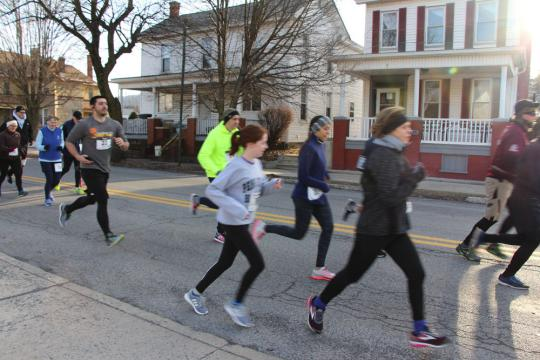 Participants run through town during the Run for Reading 5K.