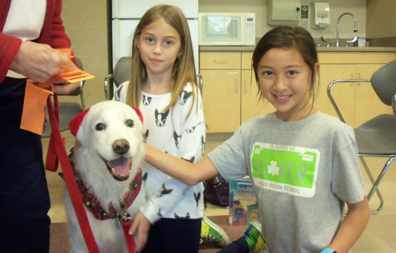 White dog with two children