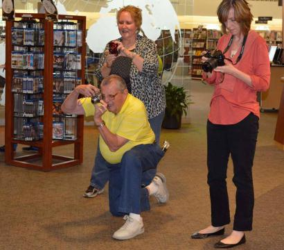 Program participants practice their camera skills in and outside the library.