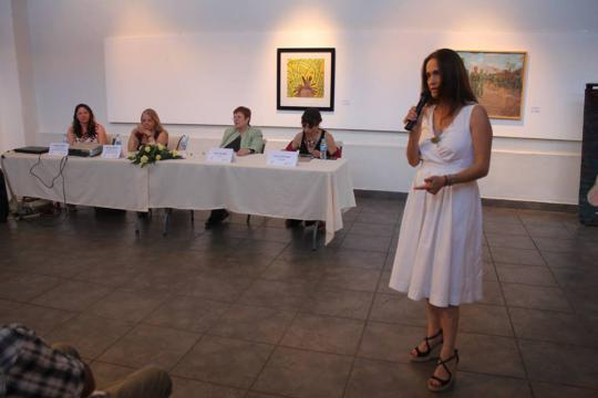 A woman speaks at a panel.
