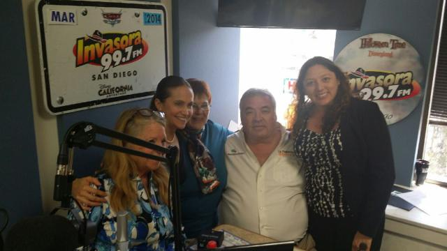 Librarians pose with a radio host after speaking about their event on air.