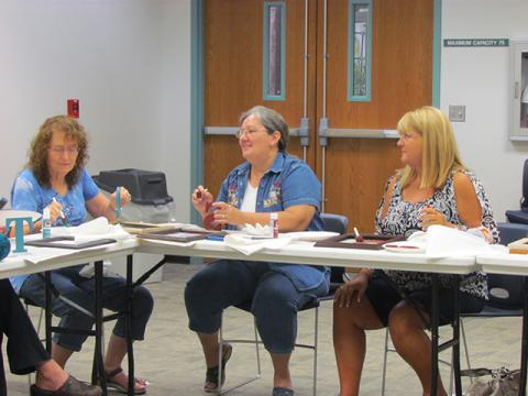 Some craft group members collaborate on the August project.