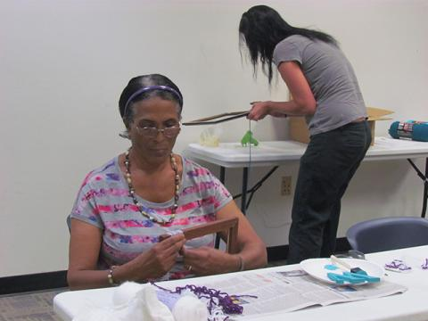 Two patrons work on creating initial frames.