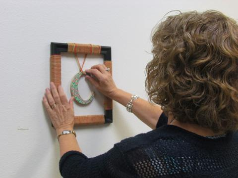One participant puts the final touches on her initial frame.