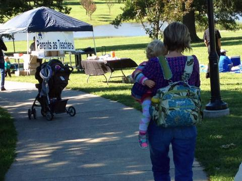 Woman and baby at Story Walk event
