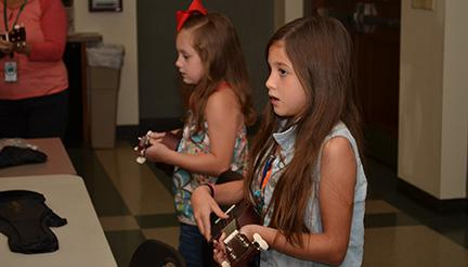"""Students learn to play """"You Are My Sunshine"""" and another song of their choosing."""
