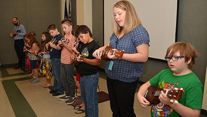 Instructors teach students how to play the instrument in groups and in one-on-one sessions.