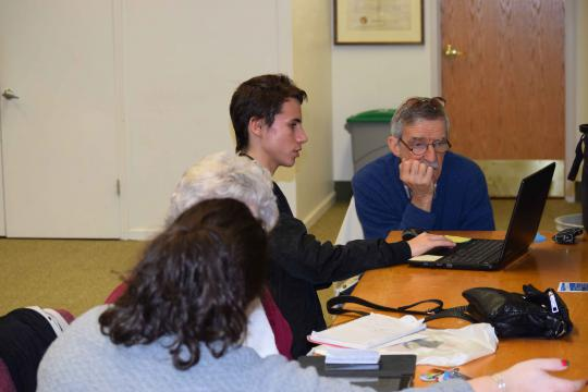 Teens tutoring older adults one-on-one