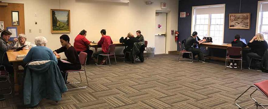 A roomful of teens tutoring