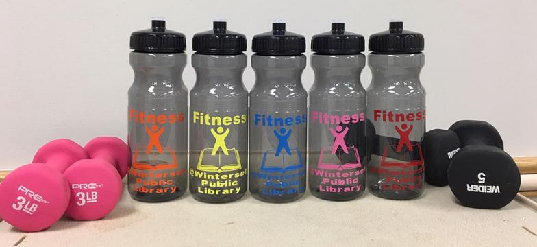 five water bottles and two sets of dumbbells
