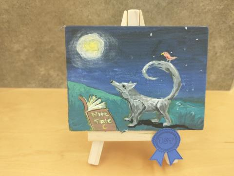Photo of art canvas with painting of wolf