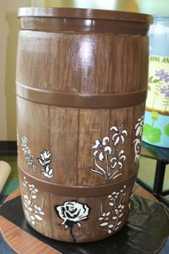 Wooden Barrel w/White Flowers: EVPL and Youth Care Center, 2014 (coordinated by Michael Cherry and Charles Sutton, Library Experience Manager)