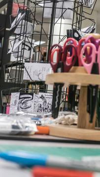 Zine exchange rack with scissors
