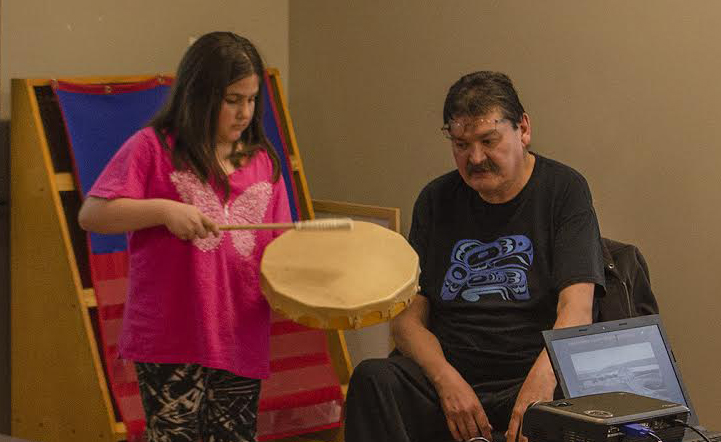 WFN elder Derry Fontaine teaches a young girl to drum
