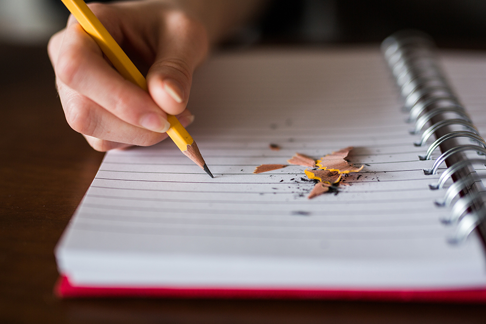A broken pencil on a notepad